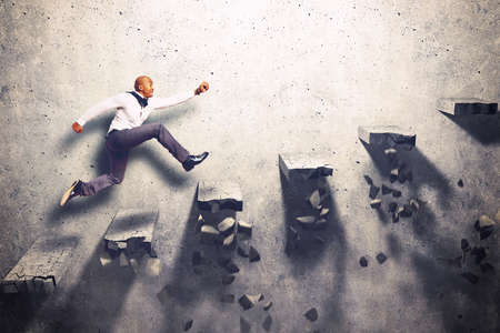 risky job: Man climbs the steps of collapsing ladder Stock Photo