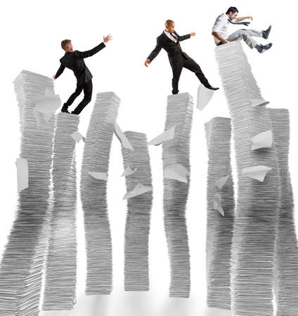 unstable: Business men of unstable piles of paper