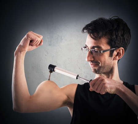 tricep: Man inflates his muscles with a pump
