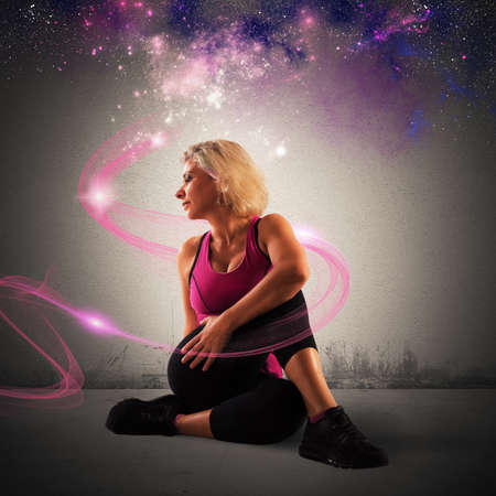 Woman in stretching position with sparkling trail