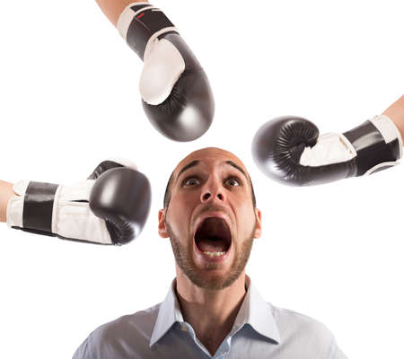 powerless: Many boxing punches hit an afraid businessman Stock Photo