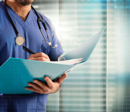 paediatrician: Doctor with stethoscope writes on medical record