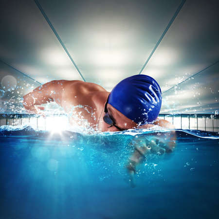 sports race: Man professional swimmer swimming in a pool