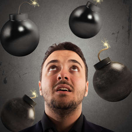 preoccupation: Man with worried expression with bombs falling