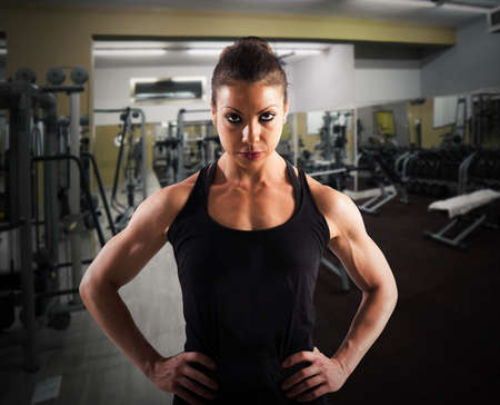 Woman with determined expression in a gym