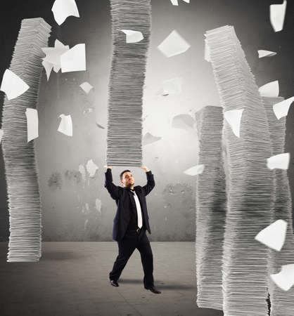 debt trap: Man holding an infinite stack of sheets
