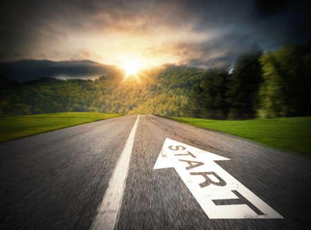 trail: Road with big white arrow on asphalt