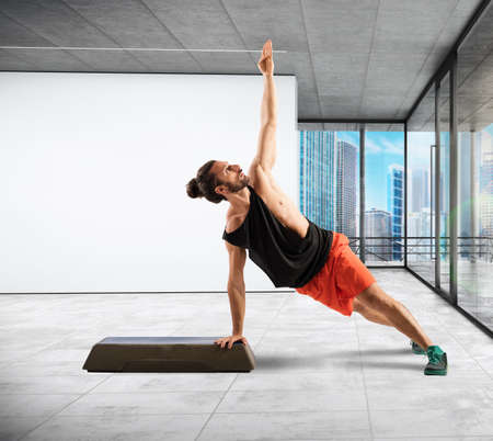 step fitness: Fitness instructor in balance on the step