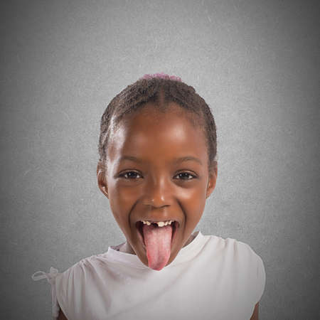 Playful little pretty girl makes a tongue Stock Photo