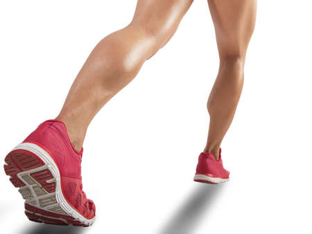 Legs of sporty woman running on white background Stock Photo