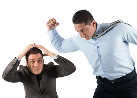 frightened: Angry big boss punches the employee frightened Stock Photo
