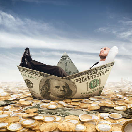 capital gains: Businessman relaxed on a boat of banknote Stock Photo
