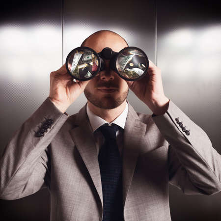 finding: Businessman sees and find money with binoculars