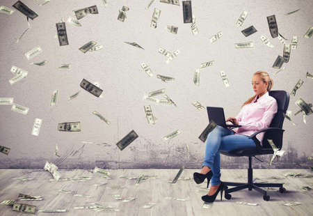 desire: Businesswoman working at pc with banknotes background Stock Photo