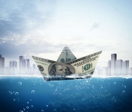 floats: Big banknote boat floats on the sea Stock Photo