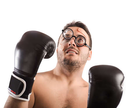 unequal: Goofy boxer with nerd eyeglasses and plasters Stock Photo