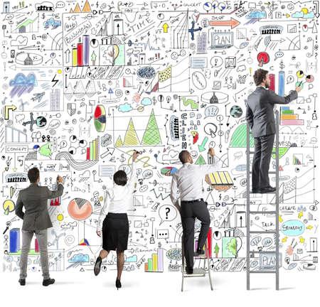 Team draws business analysis on the wall Stockfoto