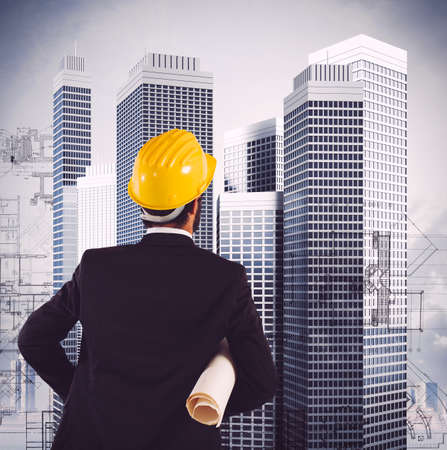 Engineer looks at a skyscrapers construction plan