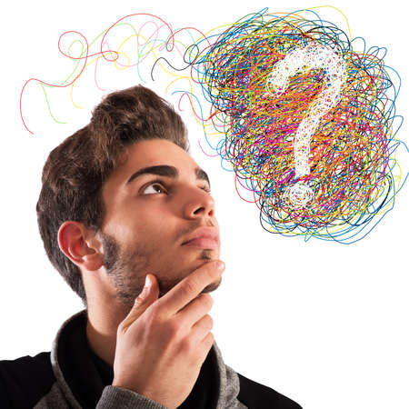 brain mysteries: Boy with thoughtful expression and question mark Stock Photo