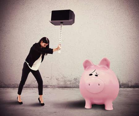 piggy: Woman breaks with a hammer a piggybank Stock Photo