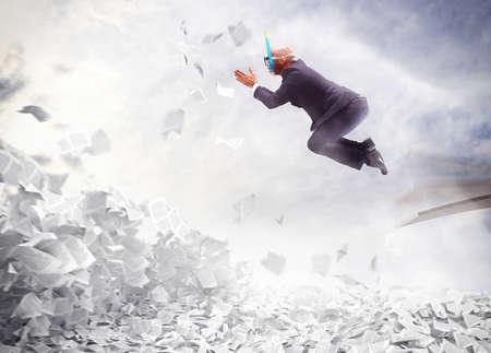 debt trap: Businessman dives into a pile of sheets