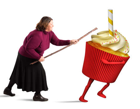 irritate: Fat woman hit with stick a cupcake Stock Photo