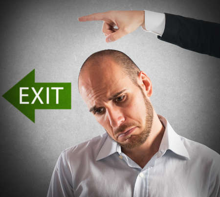 Boss indicates the exit to his employee Stock Photo