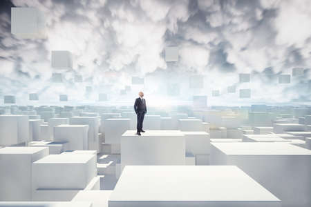 complexity: Businessman looks white cubes in the air