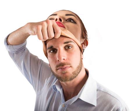 男が女のマスクを脱ぐ 写真素材