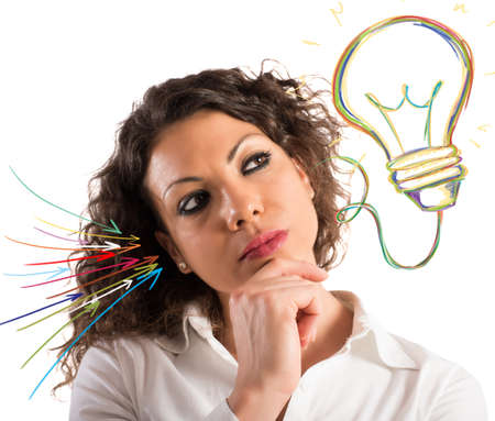 indecision: Businesswoman with thoughtful expression and a lightbulb