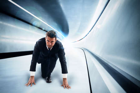 Businessman in a futuristic tunnel with lights