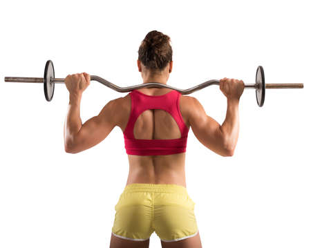 woman muscle: Muscular woman lifting an outrigger with weights