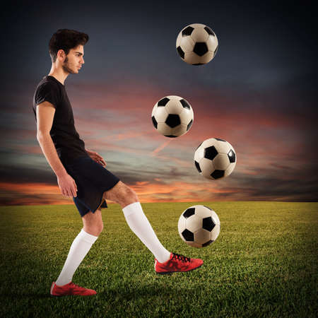 soccerball: Teenage soccer player dribbling with four soccerball