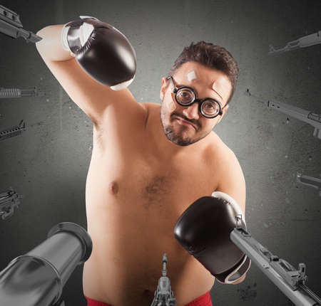 accused: Military weapons pointed on a goofy boxer Stock Photo