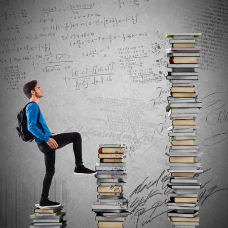 attain: Boy with backpack climbs a books scale