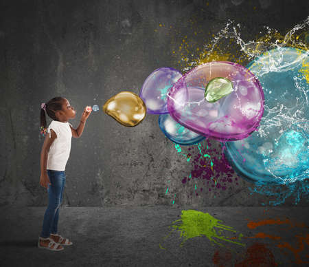Little girl makes big colorful soap bubbles