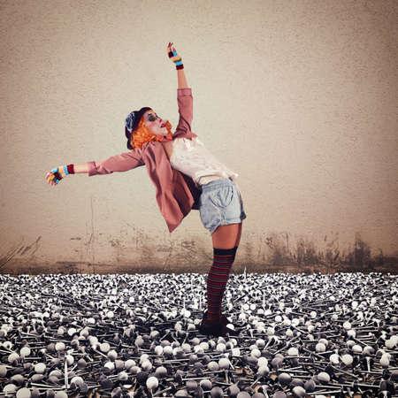pitfall: Clown walking on a floor of nails