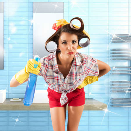 retro housewife: Simpering girl housewife with gloves and spray