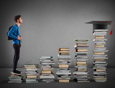 ascend: Boy climbing the stairs made of books Stock Photo