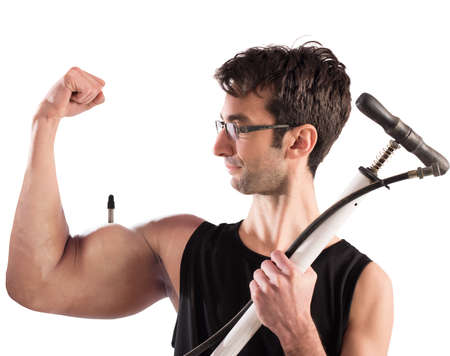 arm muscles: Boy swollen arm muscles with a pump