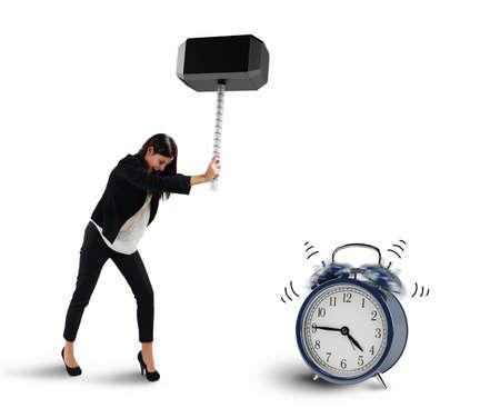 breaks: Woman breaks with a hammer an alarm