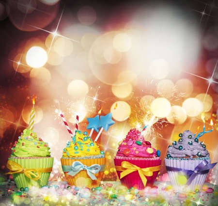 Brilliant and glowing background with colourful cupcake