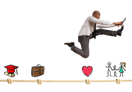 Successful businessman jumps on a life rope