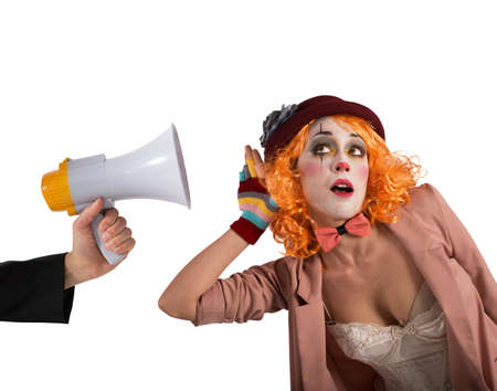 reproach: Clown hears a megaphone with alert expression