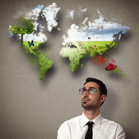 Business man imagines a natural clean world Stock Photo