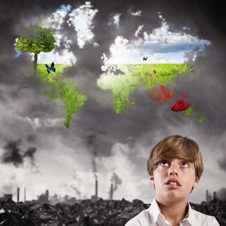 mundo contaminado: Niño niño imagina un mundo limpio naturales