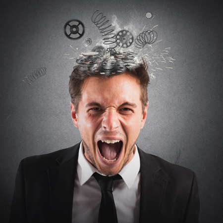 frustrate: Businessman screaming with springs jumping from head