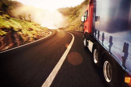 cargo van: Truck on road in a natural landscape