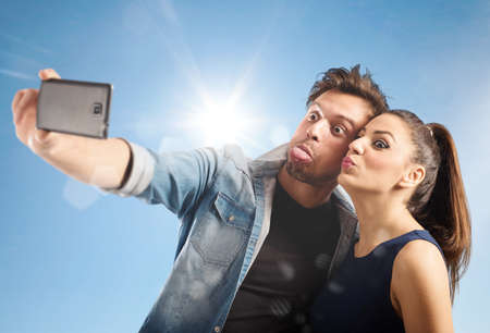 grimaces: Couple makes a grimaces while taking photo