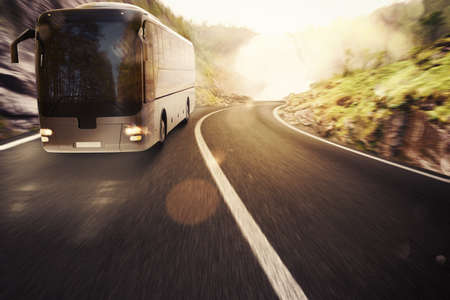 Bus driving on road with landscape background Foto de archivo
